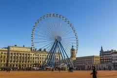 Ferris wheel Bellecour square Lyon France. Lyon, France - December 23, 2013: people by the giant ferris wheel at Bellecour square in Lyon France Stock Photography