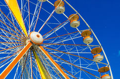 Ferris wheel on blue background Stock Photos