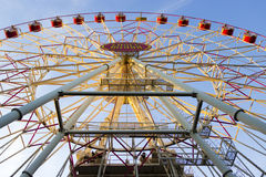 Ferris wheel on blue bright sky Stock Image