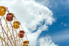 Ferris wheel with blue cloudy sky on background, summer vacation theme, copyspace Royalty Free Stock Photos