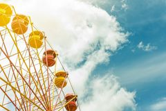 Ferris wheel with blue cloudy sky on background, summer vacation theme, copyspace Stock Photos