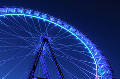 Ferris wheel with blue and light blue illumination against the d Royalty Free Stock Photos
