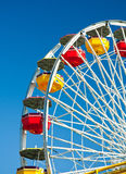 Ferris wheel in blue sky background Stock Photos