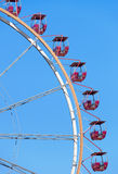 Ferris wheel with red cabins Royalty Free Stock Photos