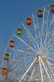 Ferris wheel. On the blue sky background Stock Photos