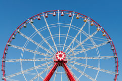Ferris wheel on blue sky background. Stock Photo
