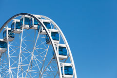 Ferris wheel on blue sky background Royalty Free Stock Images