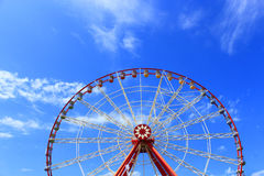 Ferris wheel on the blue sky background Stock Images