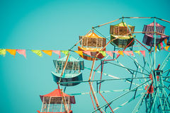 Ferris wheel. On blue sky background vintage color Stock Photography