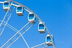 Ferris wheel on blue sky background Stock Images