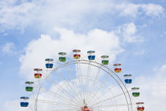 Ferris wheel with blue sky and clouds. Ferris wheel with blue sky and cloud background Royalty Free Stock Images