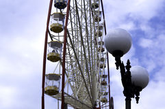 Ferris wheel on the blue sky with clouds background Royalty Free Stock Images