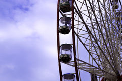 Ferris wheel on the blue sky with clouds background. Kharkiv Royalty Free Stock Images