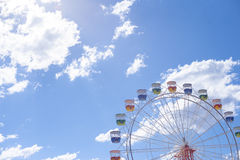 Ferris wheel with blue sky and clouds Stock Images