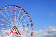 Ferris wheel and blue sky with clouds Stock Photo