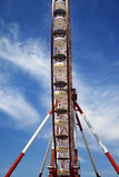 Ferris wheel and blue sky with clouds Stock Photos