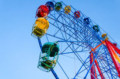 Ferris wheel and blue sky. Colorful ferris wheel over blue sky background Royalty Free Stock Images