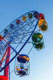 Ferris wheel and blue sky. Colorful ferris wheel over blue sky background Stock Image