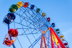 Ferris wheel and blue sky. Colorful ferris wheel over blue sky background Stock Photos