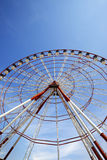 Ferris wheel and blue sky in sun day Stock Photography