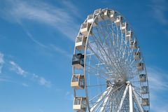 Ferris wheel on blue sky with white clouds background royalty free stock photography