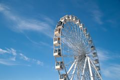 Ferris wheel on blue sky with white clouds background stock images