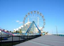Ferris wheel and boardwalk on Daytona Beach. The Ferris wheel and the boardwalk at Daytona Beach in Florida Royalty Free Stock Photos