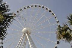 Ferris wheel at the boardwalk. Huge ferris wheel overlooking the beach Stock Images