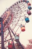 Big Ferris wheel. Bottom view. Toned vertical image in retro style. Royalty Free Stock Image