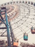Ferris wheel. Bottom view. Toned vertical image in retro style. royalty free stock photos