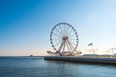 Ferris wheel in the boulevard Stock Photography