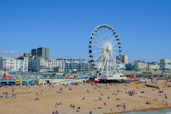 A ferris wheel on the beach against a blue sky Stock Images