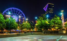 Ferris wheel and buildings seen from Olympic Centennial Park at Royalty Free Stock Photos