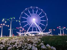 Ferris wheel on boulevard . Stock Image