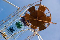 Ferris wheel cabins. Old ferris wheel cabins against a blue sky Royalty Free Stock Images