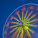 Ferris Wheel Carousel on a dark blue sky background. Royalty Free Stock Images