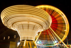 Ferris wheel and carousel, Karlsruhe. Germany. Ferris wheel and carousel at county fair at night, Karlsruhe, Germany Stock Images