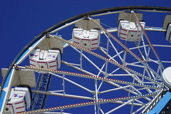 Ferris wheel cars arc higher Royalty Free Stock Image