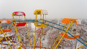Ferris wheel in the central park of the city in winter. Aerial view Stock Images