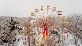 Ferris wheel in the central park of the city in winter. Aerial view Stock Image