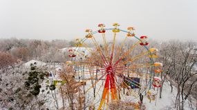 Ferris wheel in the central park of the city in winter. Aerial view Royalty Free Stock Photo
