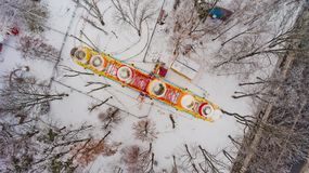 Ferris wheel in the central park of the city in winter. Top view Stock Photos