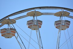 Ferris Wheel chairs. Empty Ferris Wheel chairs against blue skies Royalty Free Stock Photography