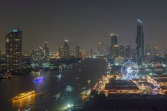Ferris wheel at Chao Phraya River, Bangkok City, Thailand.  Stock Photo