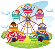 Ferris wheel. Children riding on ferris wheel  in the park Royalty Free Stock Photo