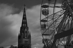 Ferris wheel & church Royalty Free Stock Image