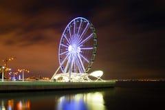 Ferris wheel on the city embankment. Night Baku, Azerbaijan stock images