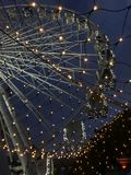 Ferris wheel in the city. Festive ferris wheel in the city in the evening Stock Photography
