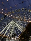 Ferris wheel in the city. Festive ferris wheel in the city in the evening Royalty Free Stock Photos