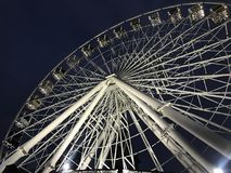 Ferris wheel in the city. Festive ferris wheel in the city in the evening Stock Image